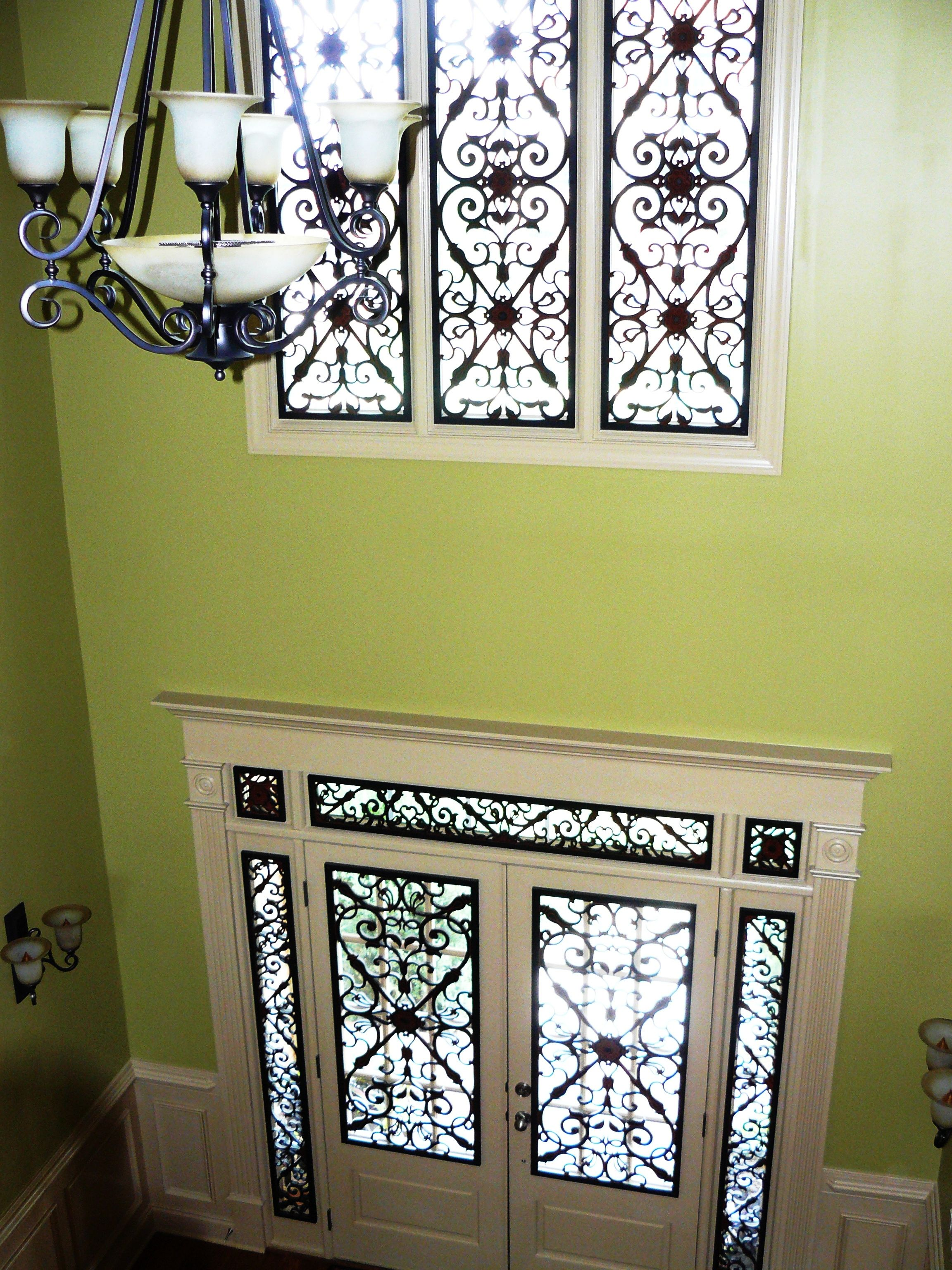 Tableaux faux wrought iron is used to unify the door and upper ...