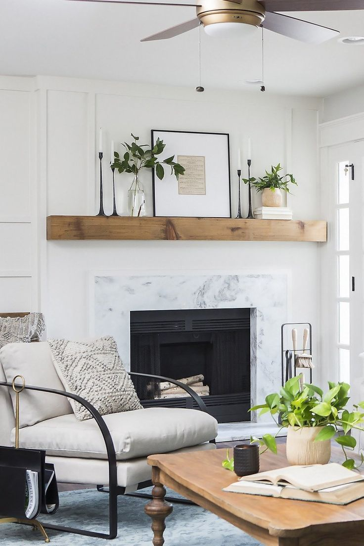gray and white living room  natural wood mantle  living
