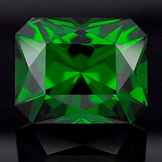 1.62 ct 100% Natural and untreated Chrome Diopside from Russia. This fine gemstone displays a very deep green color, and It was custom cut in a precise