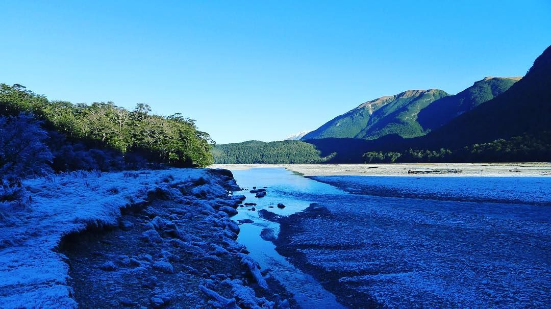 Where winter meets the river. One side is sunless all winter. The other side is drenched in winter rays. #newzealand #winter #photography