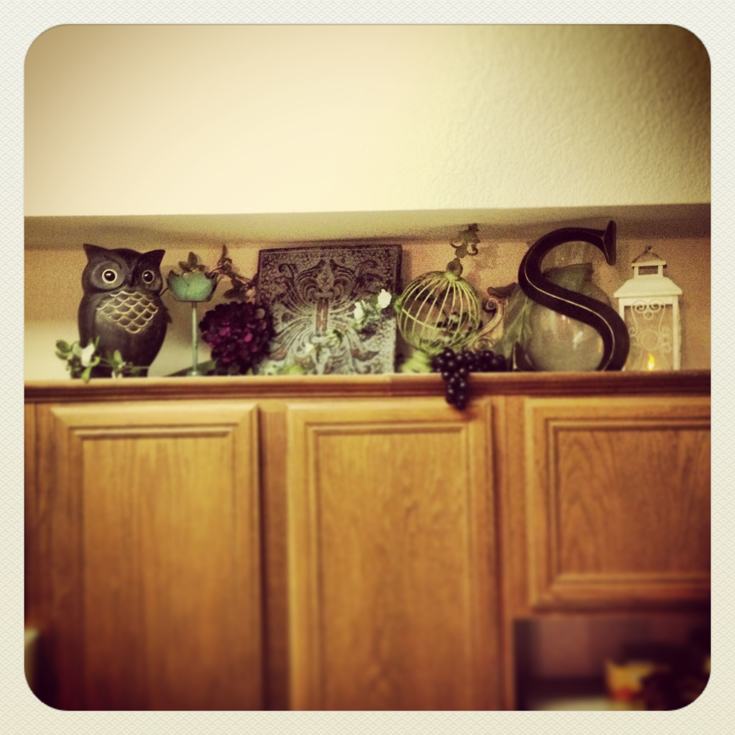 decorating above the cabinet ideas (this is a bit busy for me but I ...