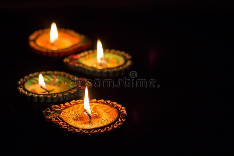 Four Burning Colorful Clay Diya Lamp Diwali Celebration Black B Ackground Sel Ad Diya Lamp Clay Burning Col Diya Lamp Diwali Diwali Celebration