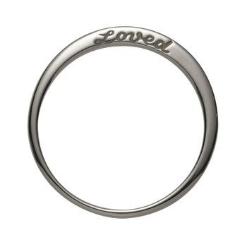 "Sterling Silver Loved Ring. It's engraved with ""loved"" on one side and has two diamonds on the other."