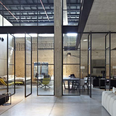 bb italia showroom by israeli architects pitsou kedem  - Silicate panels line the western wall of the 11-metre-high hall, while other interior walls are clad in concrete panels.