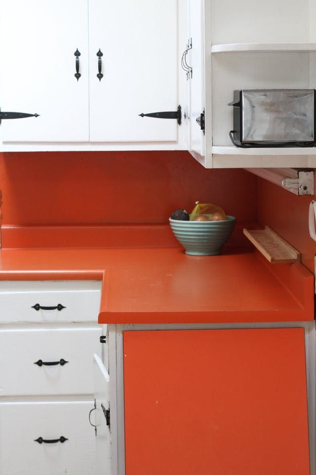 If replacing your laminate countertops isn't an option, painting your existing kitchen counters using a coating kit is a great way to achieve a fresh look.