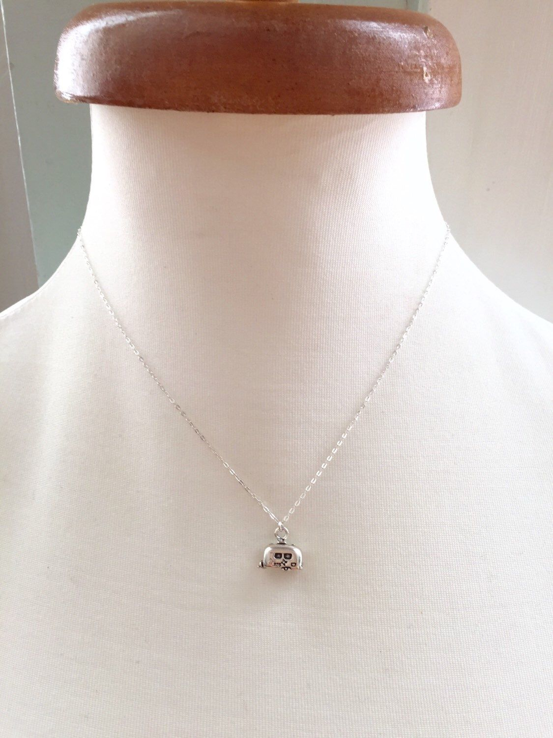 Vintage trailer/camper sterling necklace on a dainty sterling silver chain.  A personal favorite from my Etsy shop https://www.etsy.com/listing/245589456/rose-necklace-mauve-rose-pendant