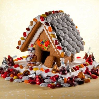 Why not add a house to your house's table? This adorable Gingerbread House is decorated for Thanksgiving and will make a beautiful centerpiece for your table, and then serve as a tasty dessert when the meal is through.