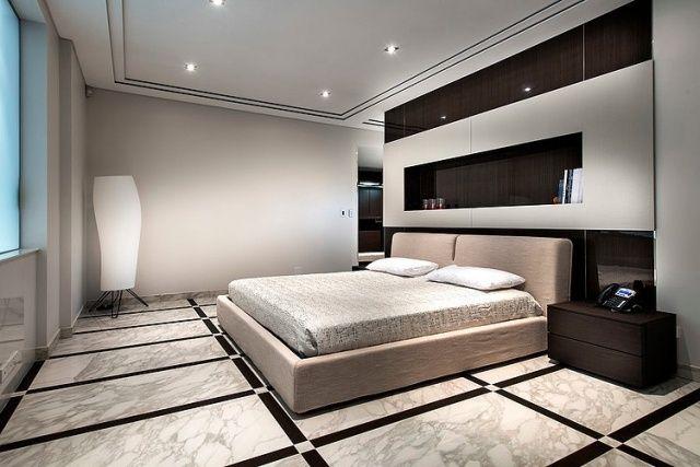 une chambre à coucher moderne avec un reveement de sol aspect ...