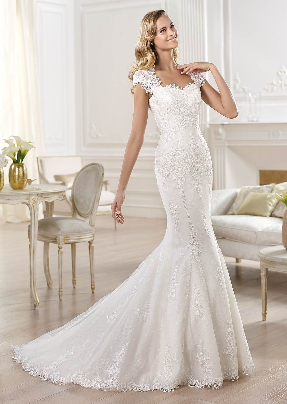 Mermaid Style Tulle And Lace Wedding Gown With A Fitted Waist That Flows To Pleated Flared Skirt Chapel Length Train This Dress Features Straight
