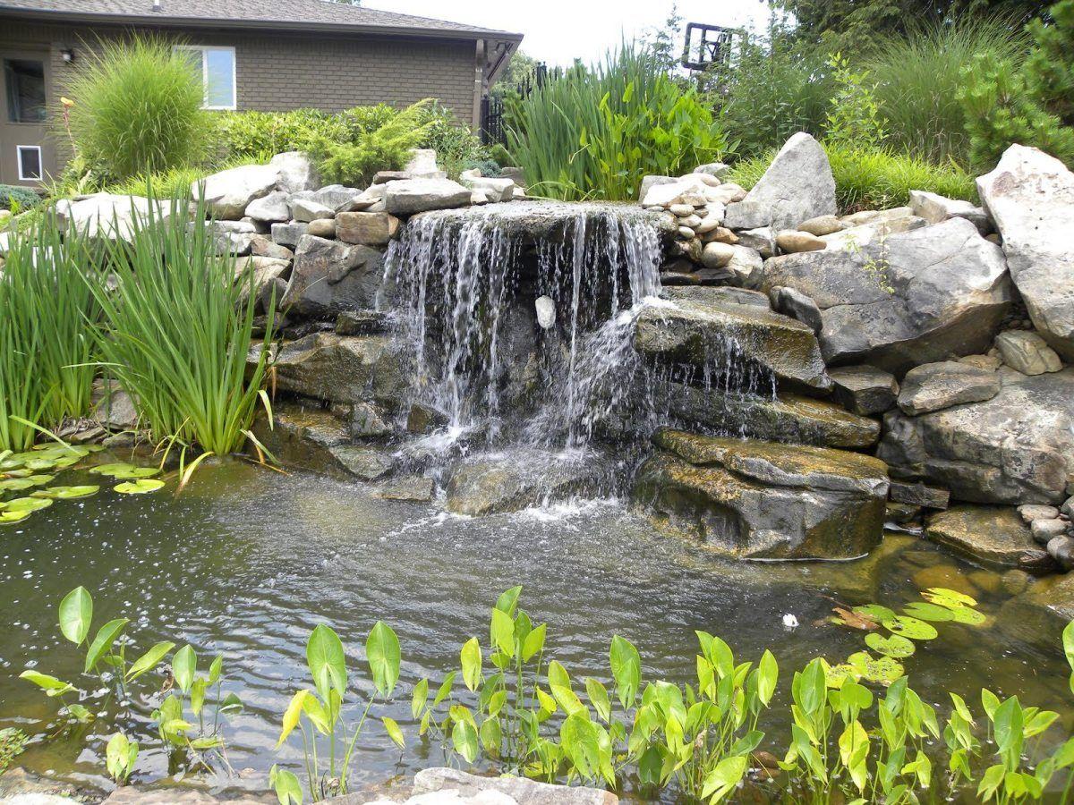 Man Made Waterfalls In A Water Garden Koi Pond Pond Patio Pond