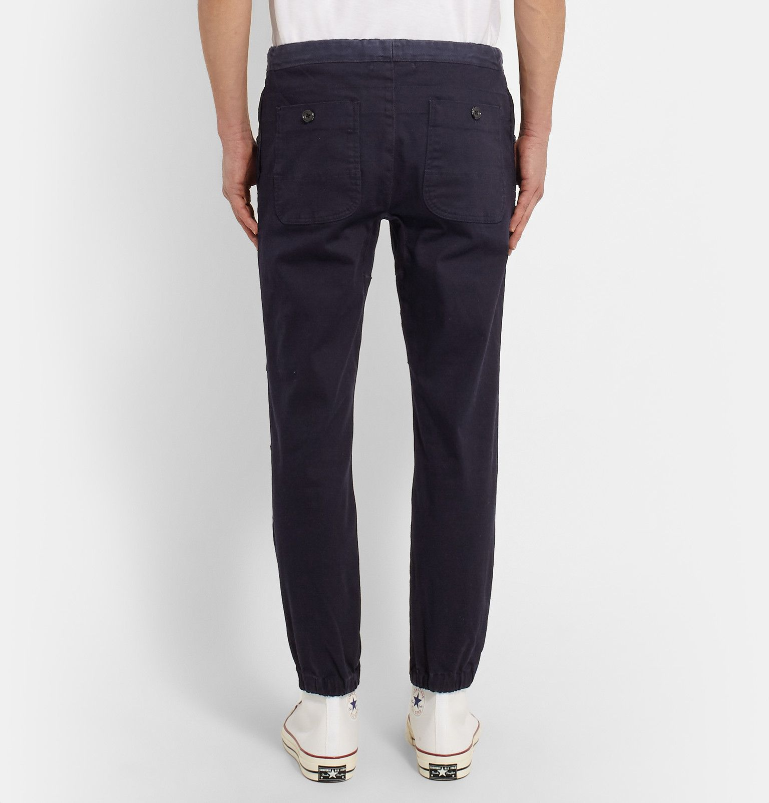 Finished with slightly cropped, cuffed legs, these Beams Plus trousers have a cool, contemporary shape. The waistband has a textured twill panel while white cotton drawstrings offset the deep navy shade. Try wearing them with an oversized T-shirt or hoodie for a comfortable casual look.