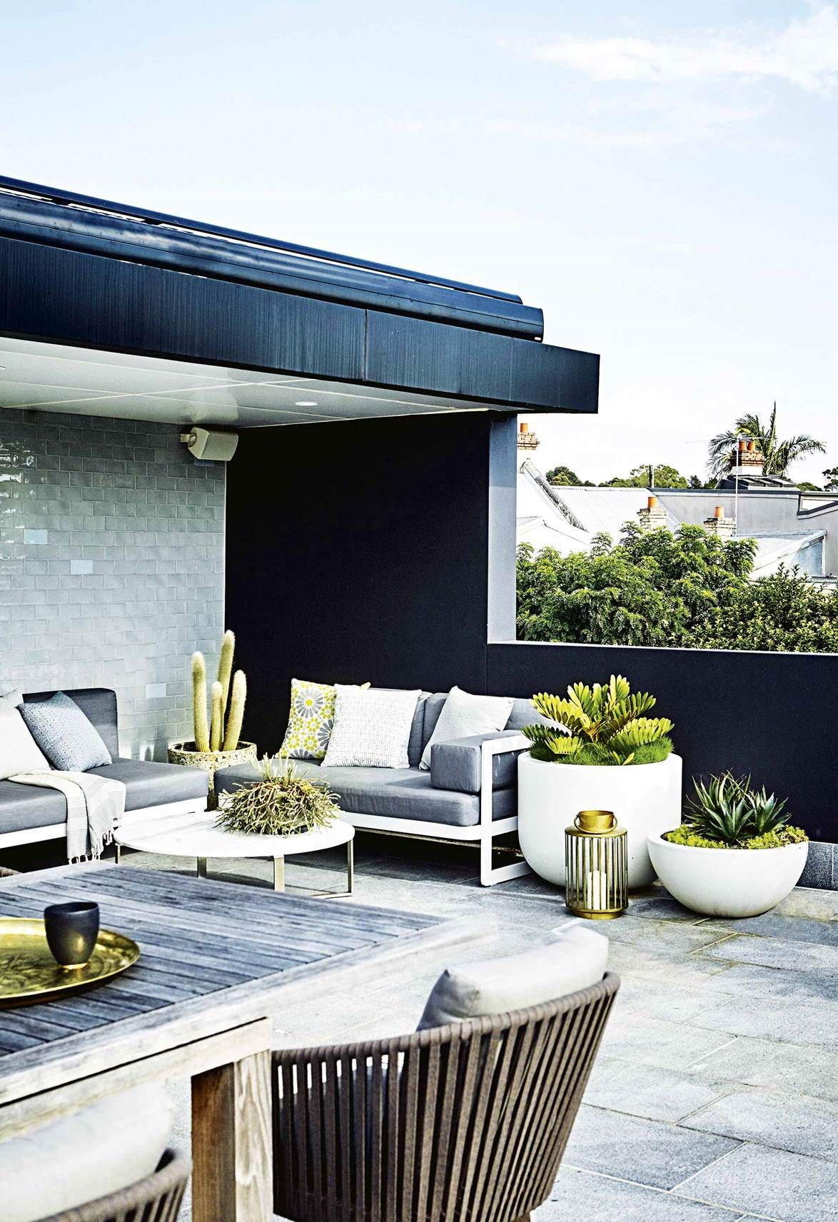 This rooftop terrace features a low-maintenance garden ...