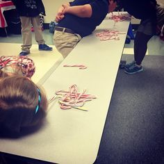minute to win it candy cane game try to hook as many as you can with the candy cane in your mouth hilarious and so fun that i want to play with