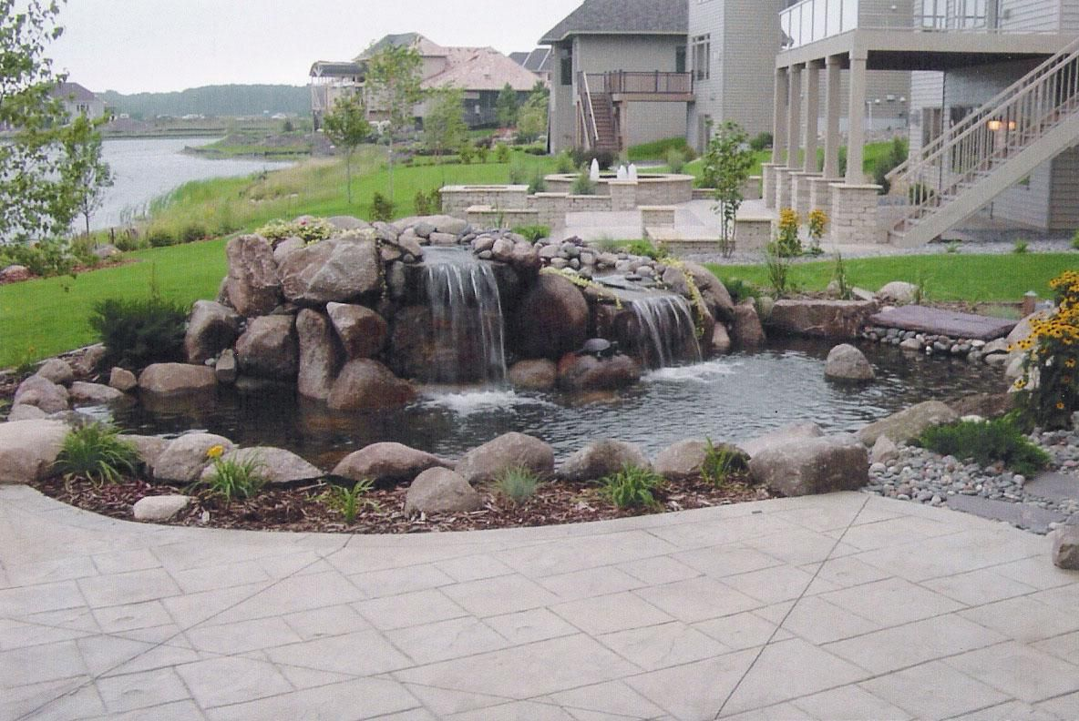 Waterfall ponds back yard pond and waterfall clever for Rock ponds designs