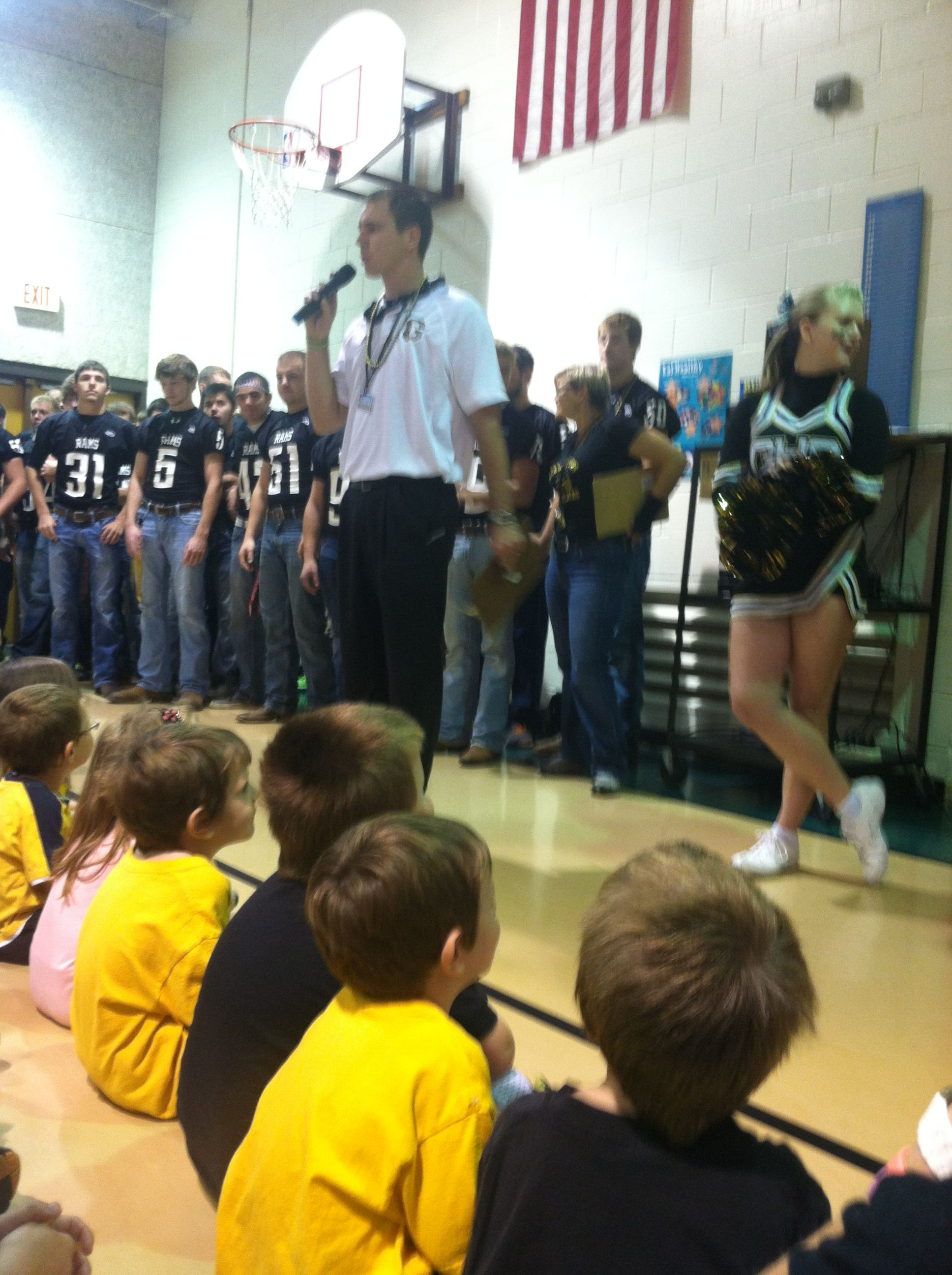 Athletic/activity director talks to the kids at the