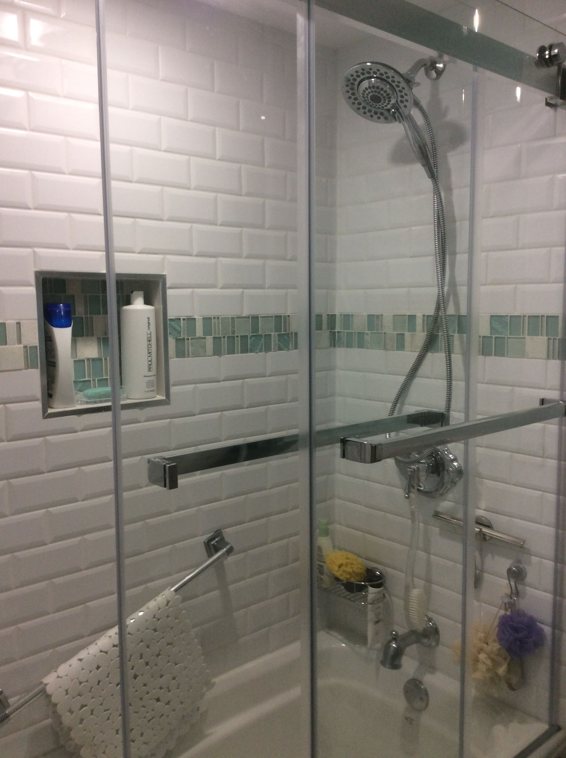 Shower In My New Bathroom Reno White Beveled Subway Tiles