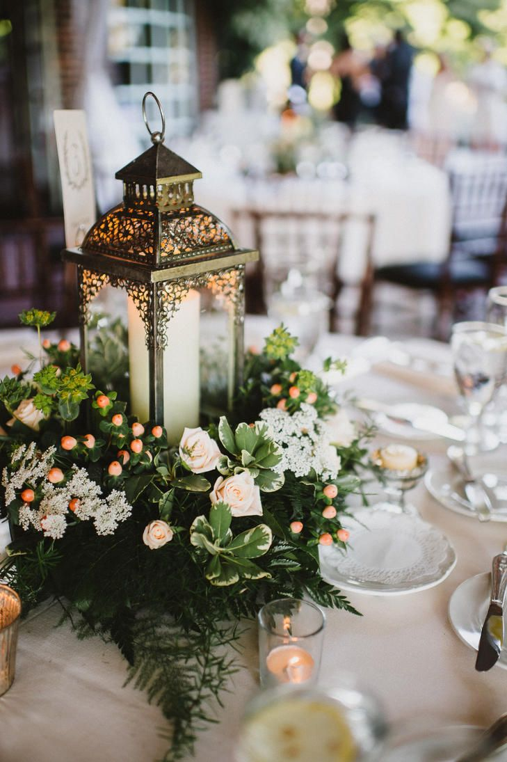 Lantern and greens centerpiece centerpieces in