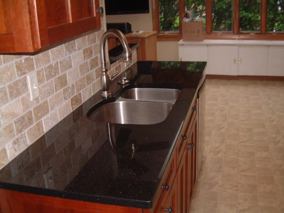 Black Granite Countertops With Tile Backsplash