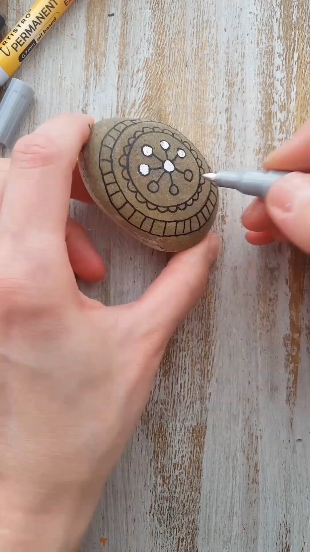 Photo of Rock Painting with Silver Paint Pens