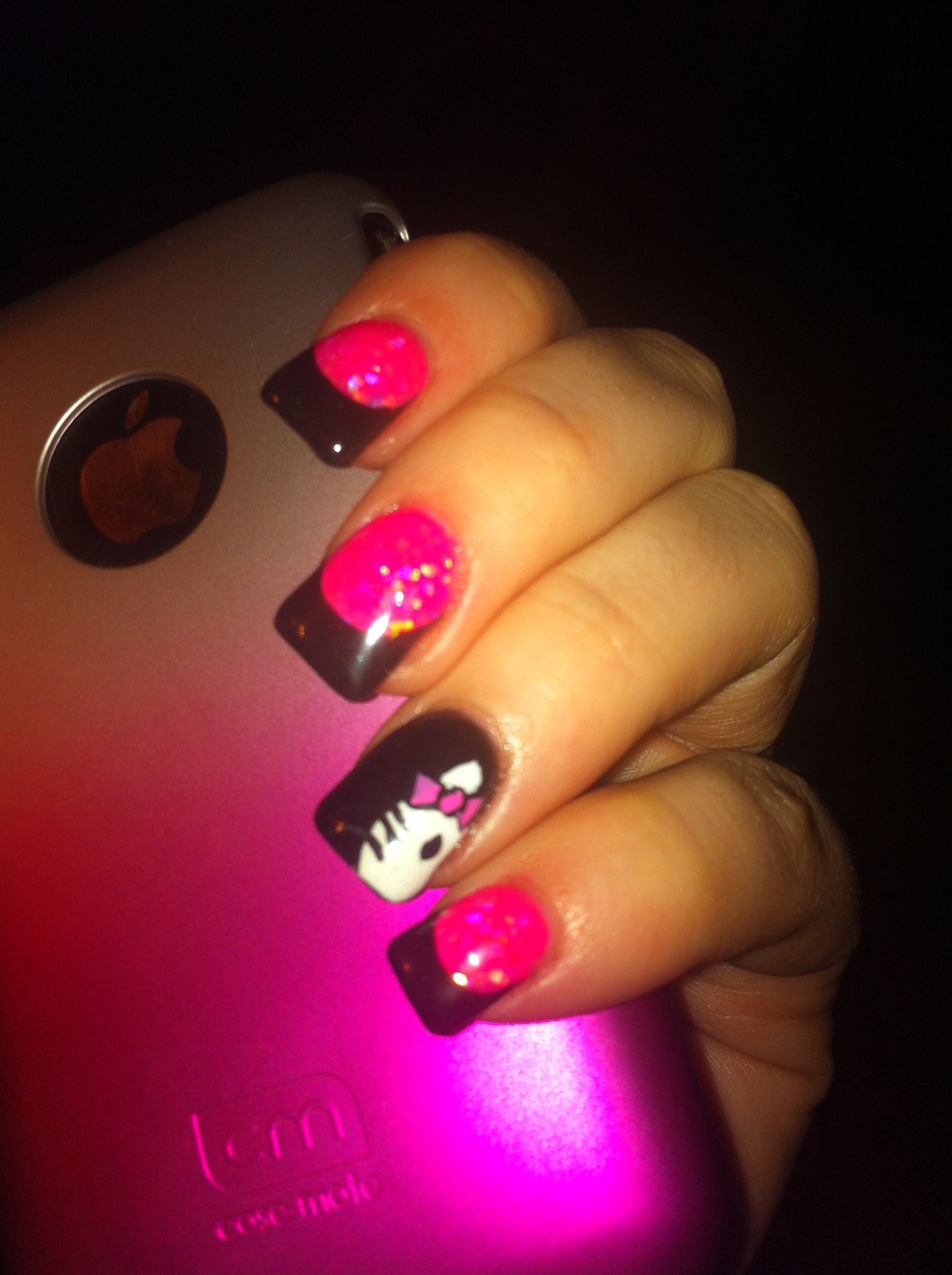 black tips acrylic nails with hello kitty art and hot pink