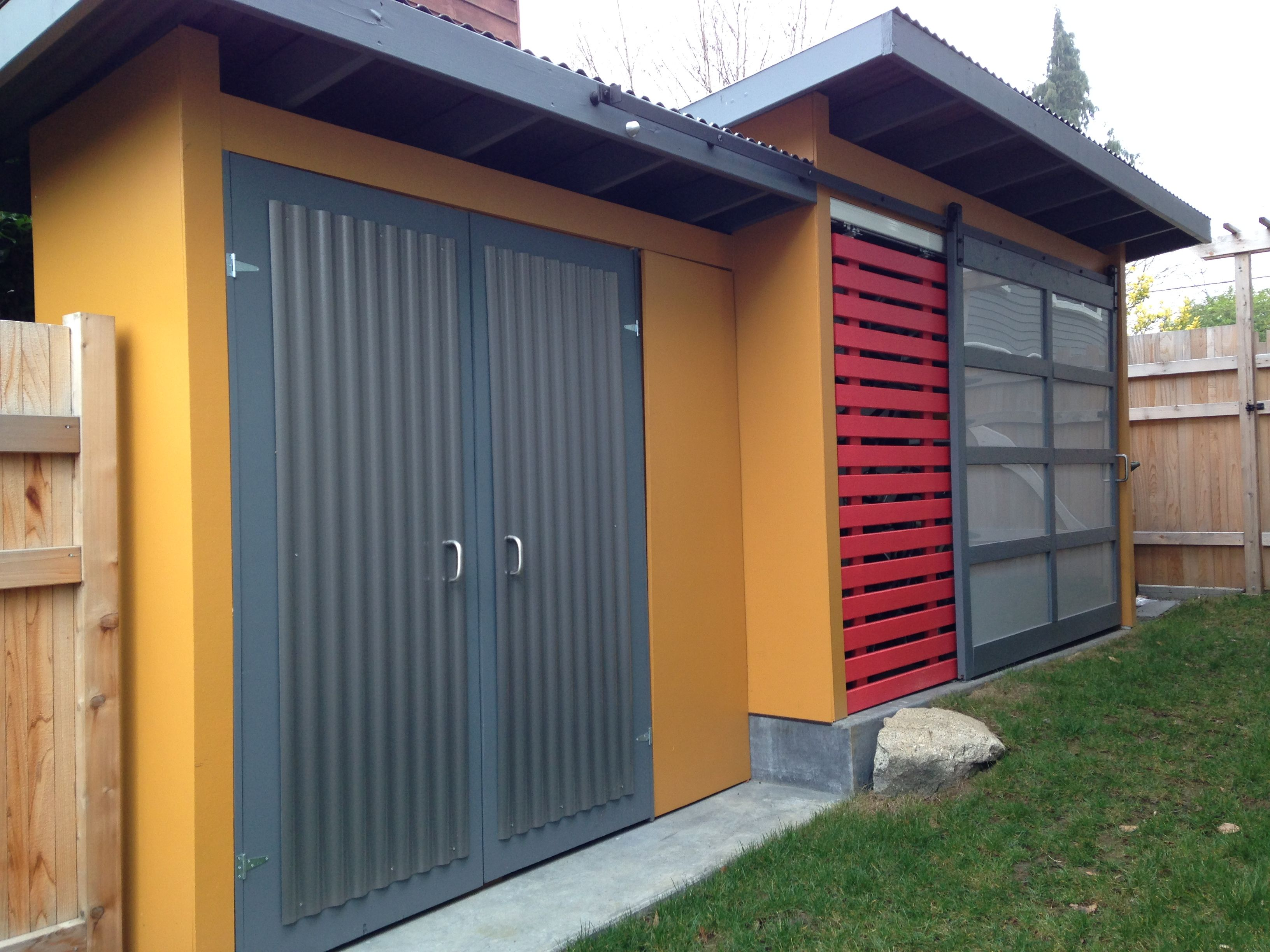 Beautiful Storage Shed In Side Yard Of Hardy Tropical Garden Has Rolling Barn Doors  For Easy Access. Depth Is Staggered To Reduce The Impact Of The Size In The  Narrow ...