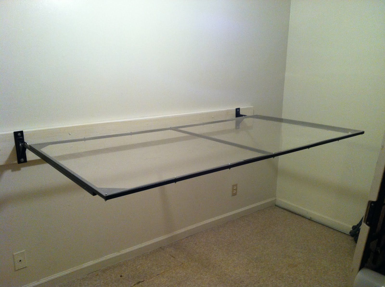 Glass Surface Laundry Room Folding Table Placed On White Wall ...