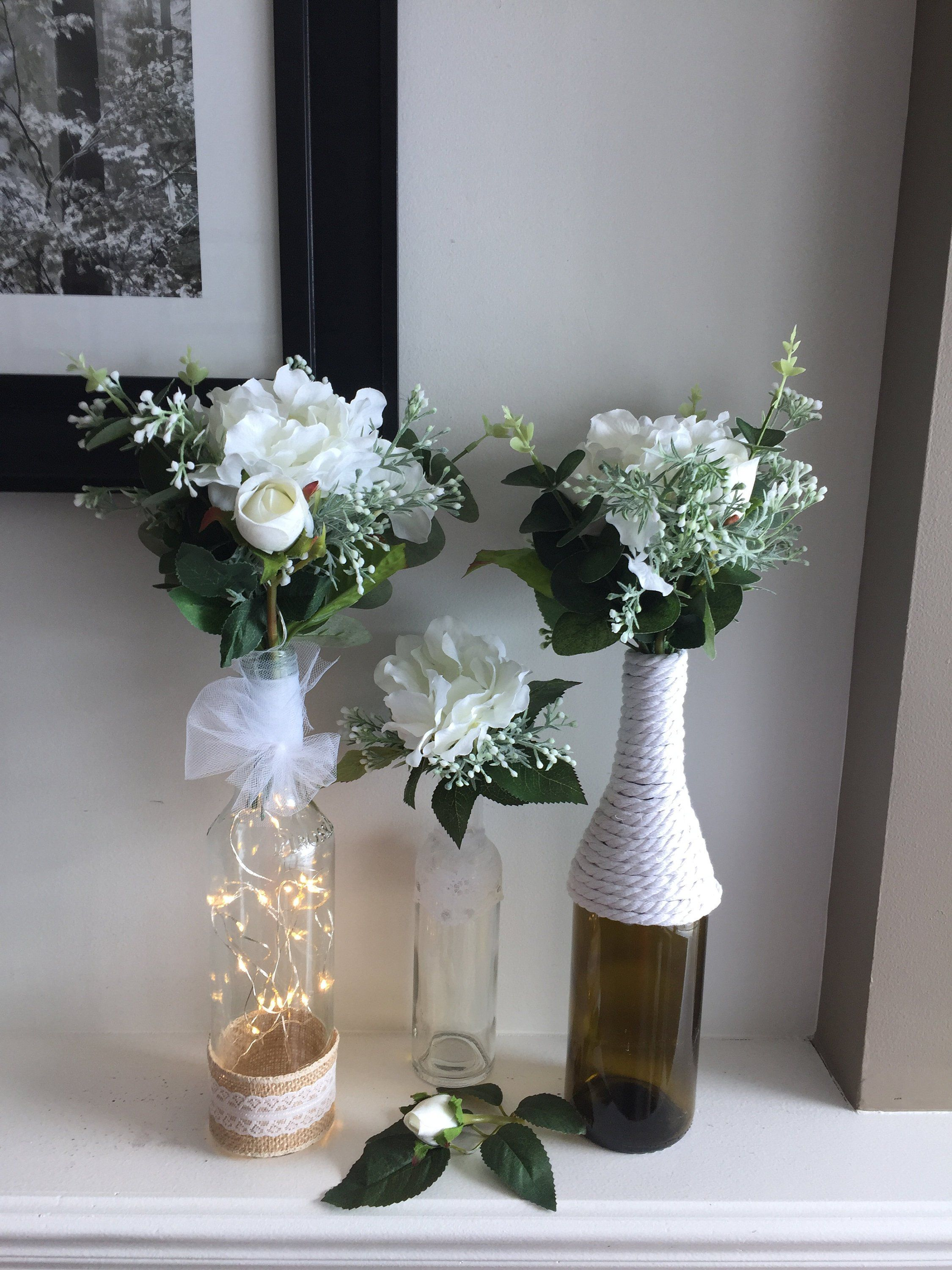 Photo of Set of 3 Wine Bottles centerpiece with flowers included, Wedding table decorations, Wine bottle vase, Flowers centerpieces, Decorated bottle