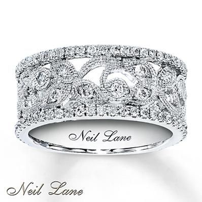 There's no reason your left hand should have all the fun. This beautiful right hand ring from the Neil Lane Designs collection features beautiful scroll detail.