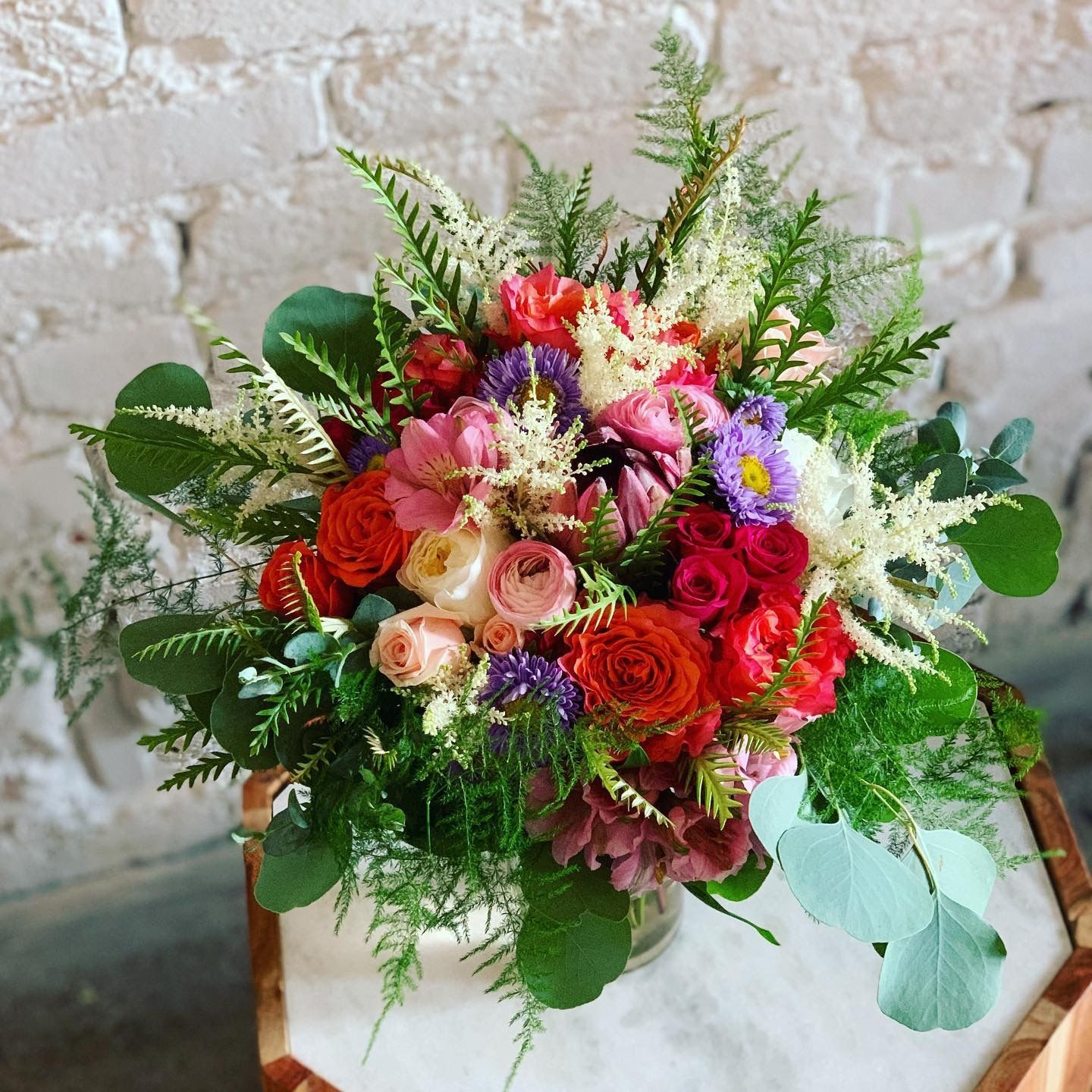 Colorful Wedding Bouquet  #astilbebouquet Colorful bride's bouquet with roses, proteas, ranunculus, astilbe, ferns, eucalyptus. Flowers by Rhinestones and Roses #astilbebouquet