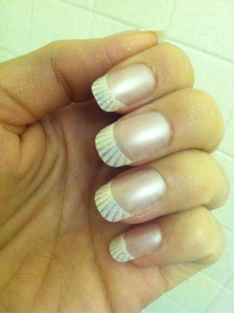 File lightly the apply glue to the nails press down firmly