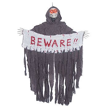This Hanging Reaper w/Beware Banner is a horrible creature with - halloween decorations at walmart