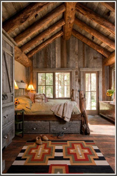 Beautiful room. I love the weathered wood furniture - the wardrobe and bed (with storage underneath!) and chest. And the beams ... sigh. Maybe someday I'll get to build a cabin in the mountains, mainly just so I can have exposed beams. ; )