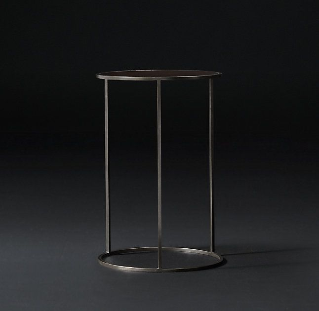 RH's Monroe Slimline Round Cocktail Side Table:Designed by Anthony Cox, our table captures the spare functionalism that defined French furniture of the 1960s. With its slender metal frame, inset top of finely grained wood and refined mix of materials, it occupies a minimum of visual space while making a striking statement.