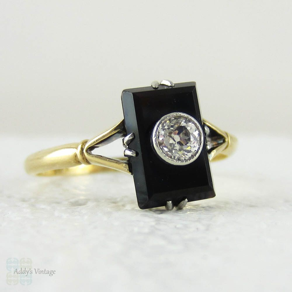 1920s Onyx & Old Mine Cut Diamond Panel Ring, Art Deco Double Claw Design Setting in 18 Carat Yellow Gold. by Addy on Etsy https://www.etsy.com/listing/220818663/1920s-onyx-old-mine-cut-diamond-panel
