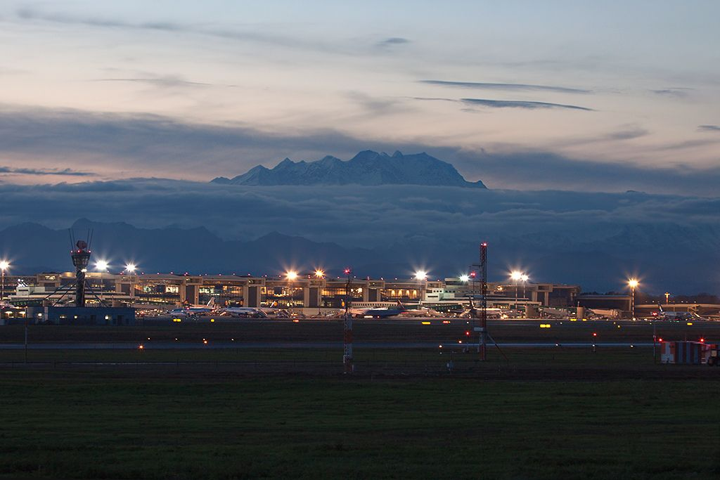 Monte Rosa tip above the clouds and milan MXP airport just below