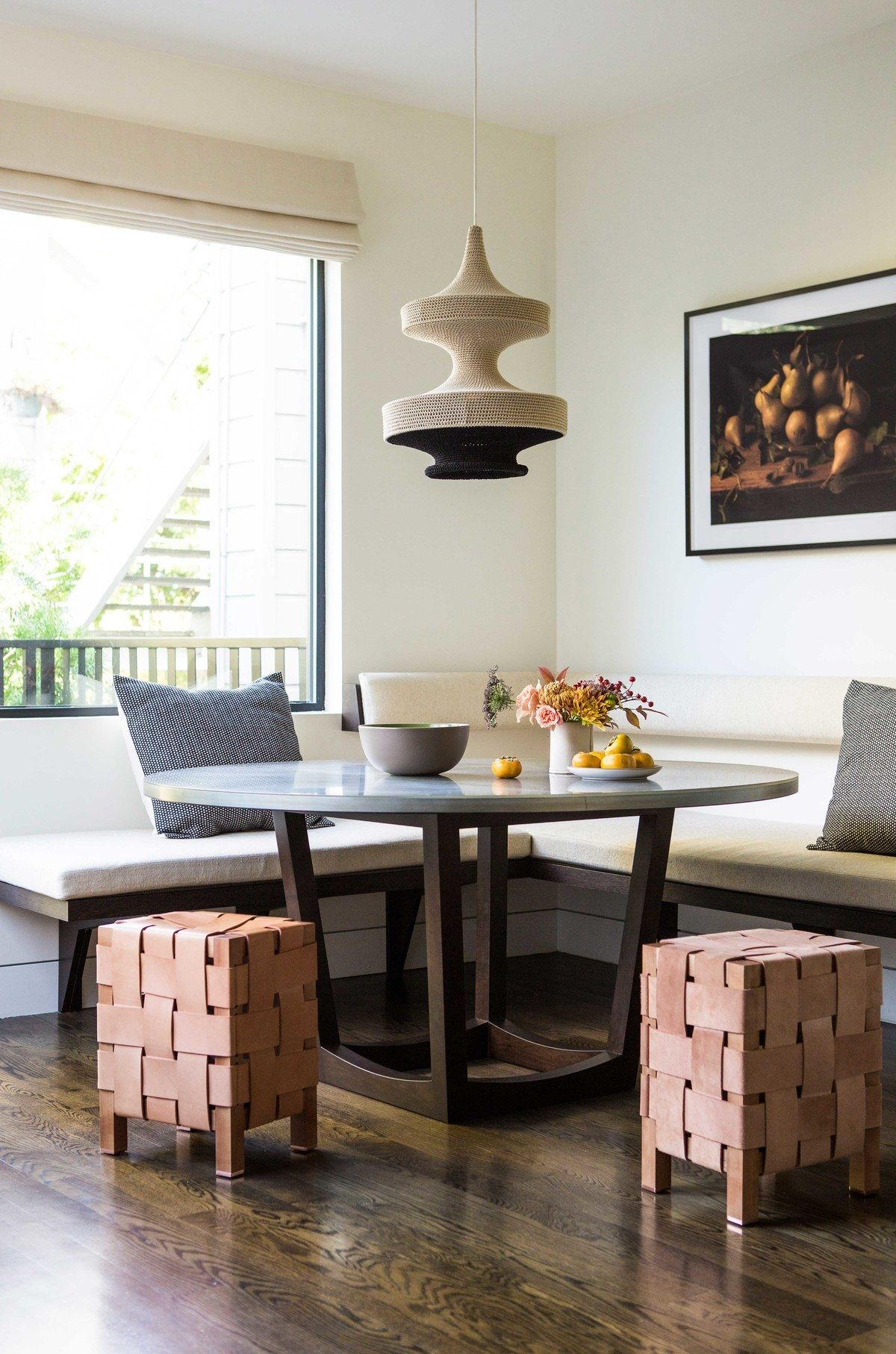 A breakfast nook off the kitchen is flooded with natural light ...