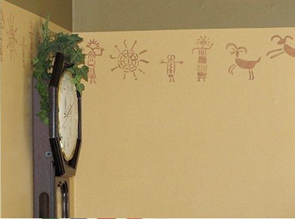 Wall to Wall Stencils gallery picture example Petroglyphs stencilednear  clock on a wall