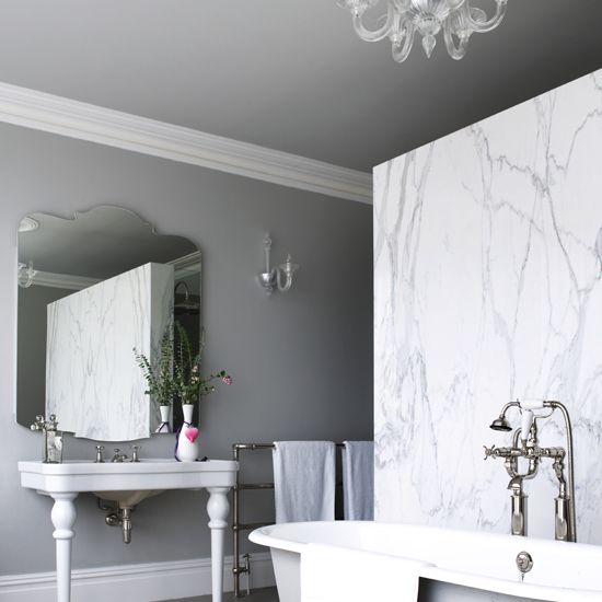 Grey and white bathroom with marble wall