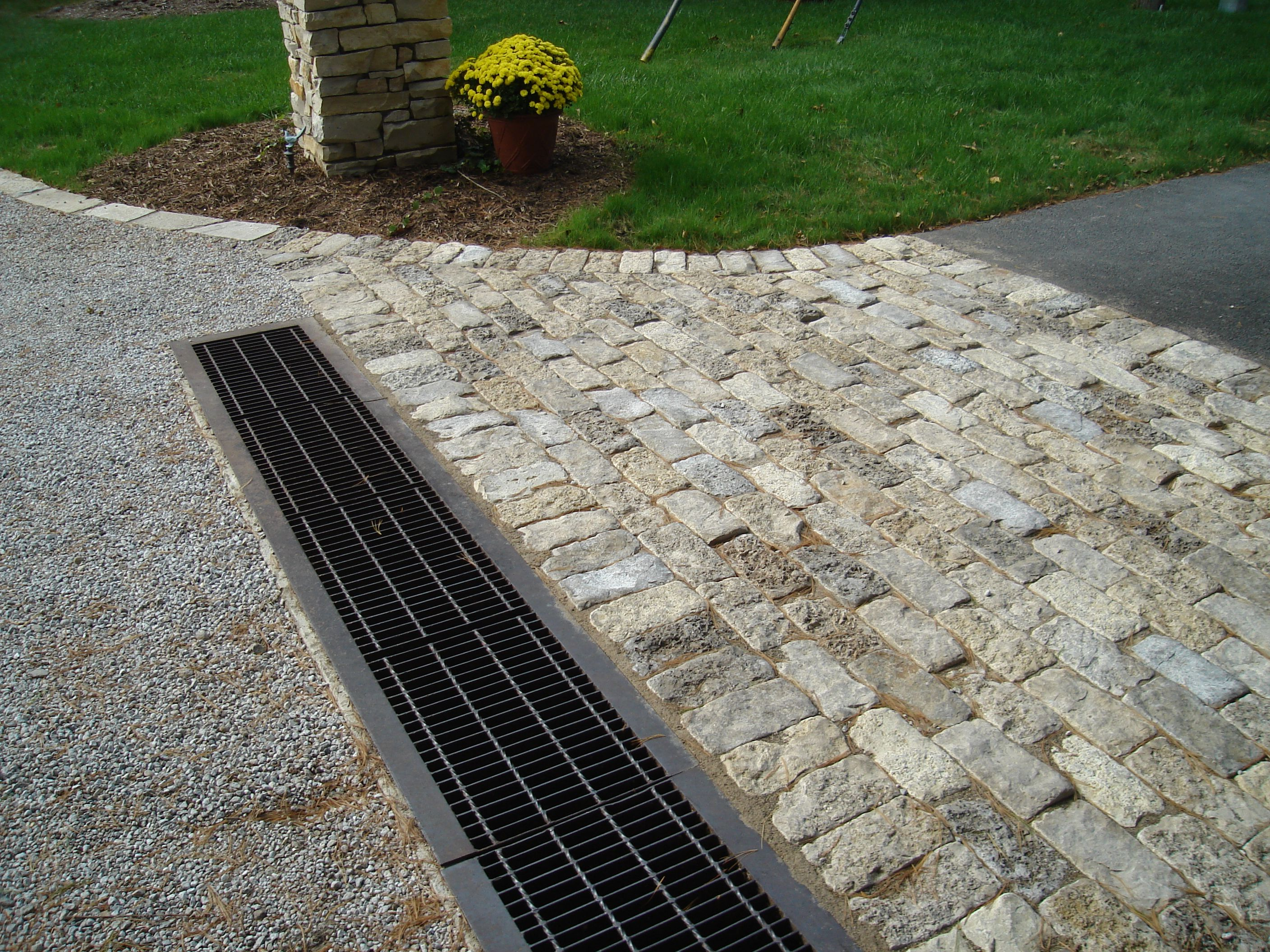 drainage road pin drain trench the grate driveway at top with of sloped channel for garage