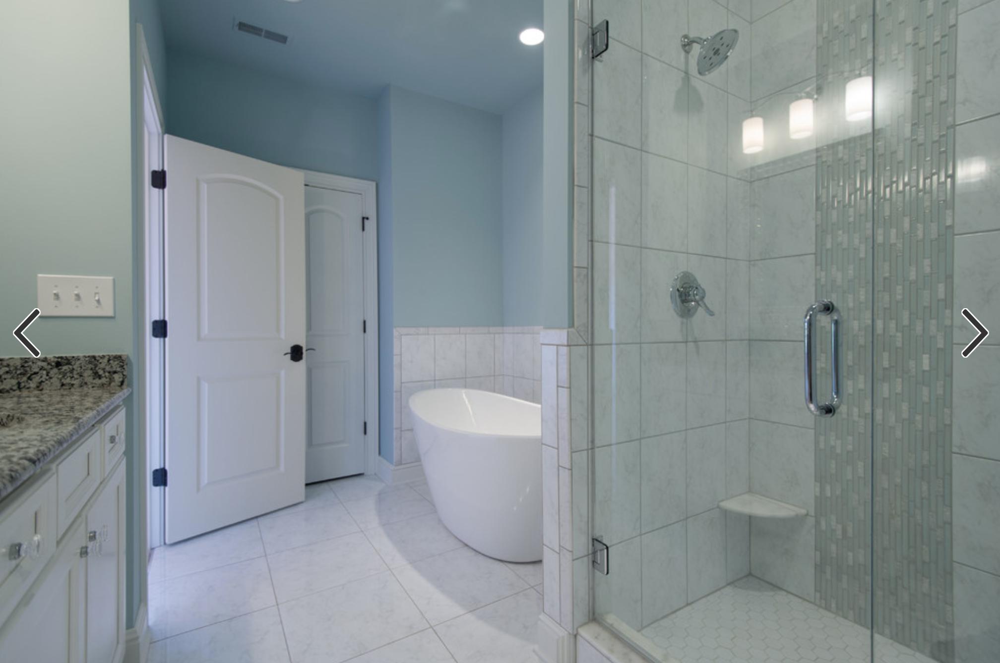 Houzz | Same large tile on shower wall and bathroom floor. Tile ...
