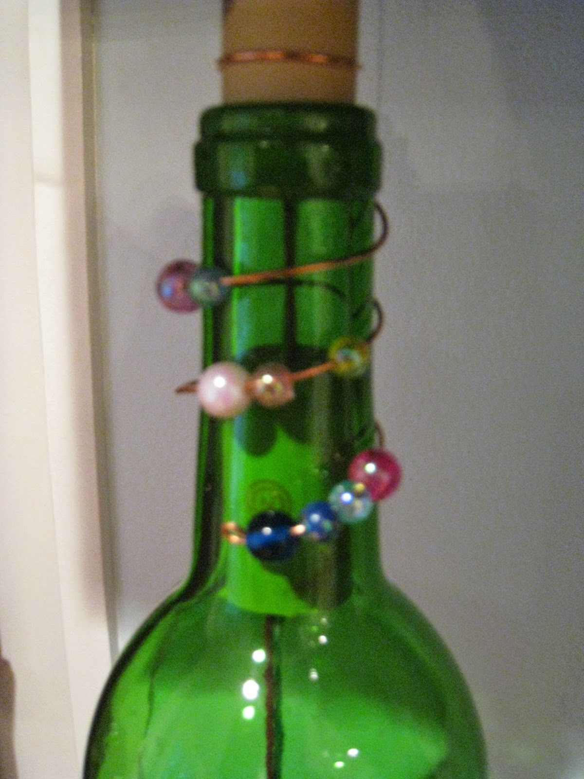 Repurposed for life wine bottle wind chimes crafts for Glass bottle wind chimes