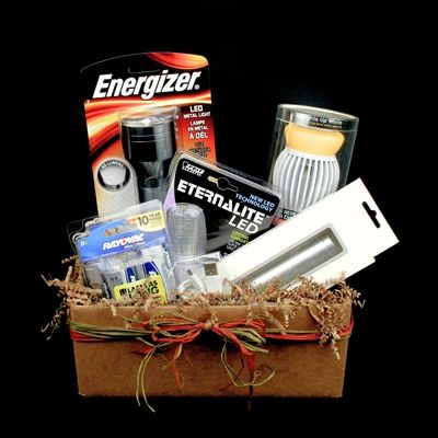 """The """"Grandpa"""" gift basket contains a selection of items that will help to make your grandpa's life easier. It includes an LED bulb which he can use to make it easier for him to read his favorite book or magazine. It also includes an automatic sensor LED night light, a metal flashlight with batteries, and a rechargeable USB power bank with an extra charging cable. He will never be without a charged up cell phone again!"""