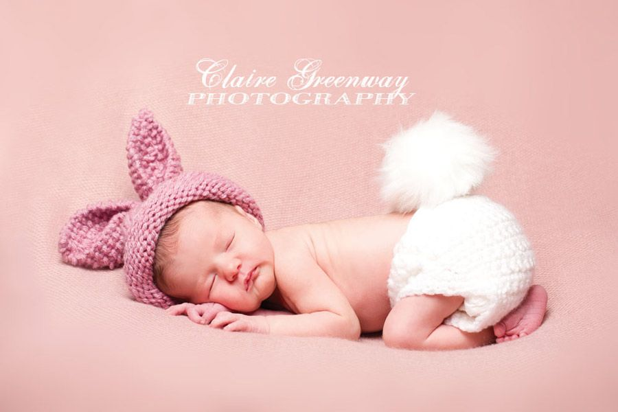Surrey newborn baby photography portrait session of sleeping baby at home pictured in knitted rabbit hat
