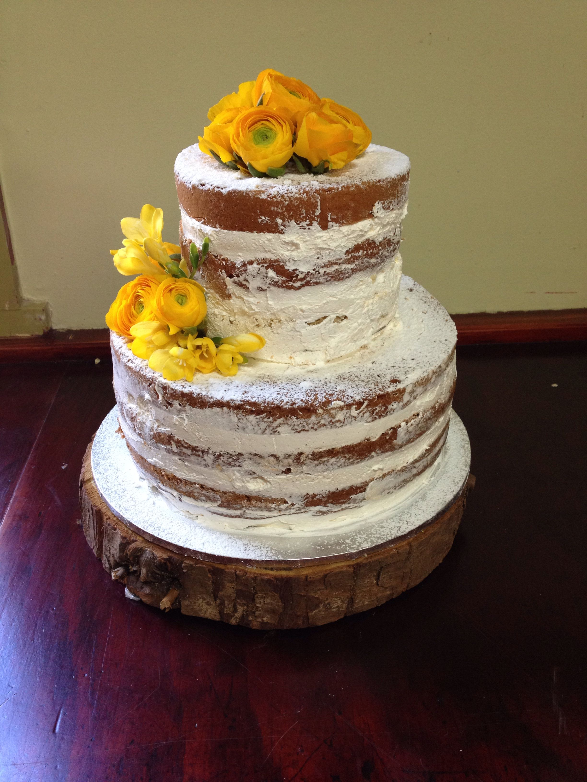 Naked cake with yellow flowers