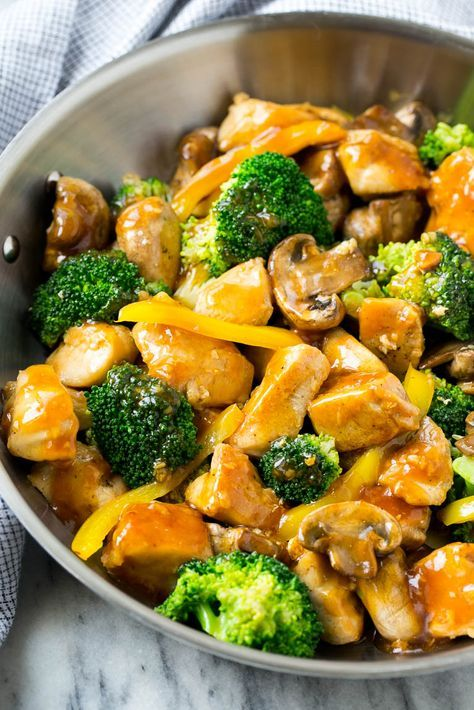 This garlic chicken stir fry is a quick and easy dinner that's perfect for those busy weeknights! Cubes of chicken are cooked with colorful veggies and tossed in a flavorful garlic sauce for a meal that's way better than take out! #stirfrysauce