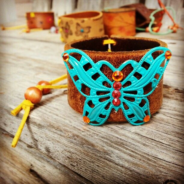 Turquoise butterfly leather cuff.