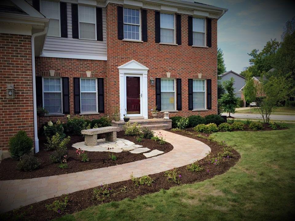UNILOCK brick paved walkway and surrounding landscaping