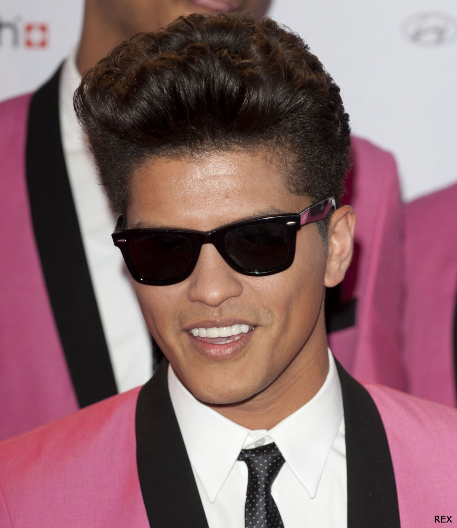 abe757bb14 Bruno Mars with quiff and sunglasses looking very James Dean at the MTV EMA  Awards.
