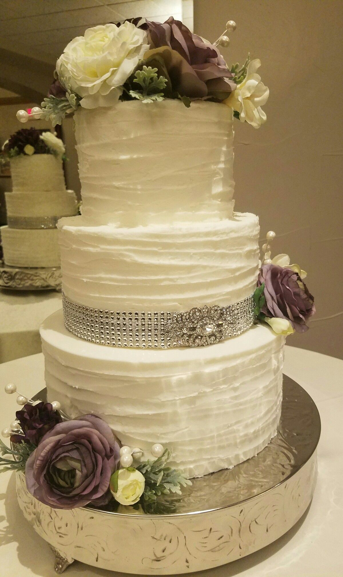 purple and white flowers and bling rustic wedding cake