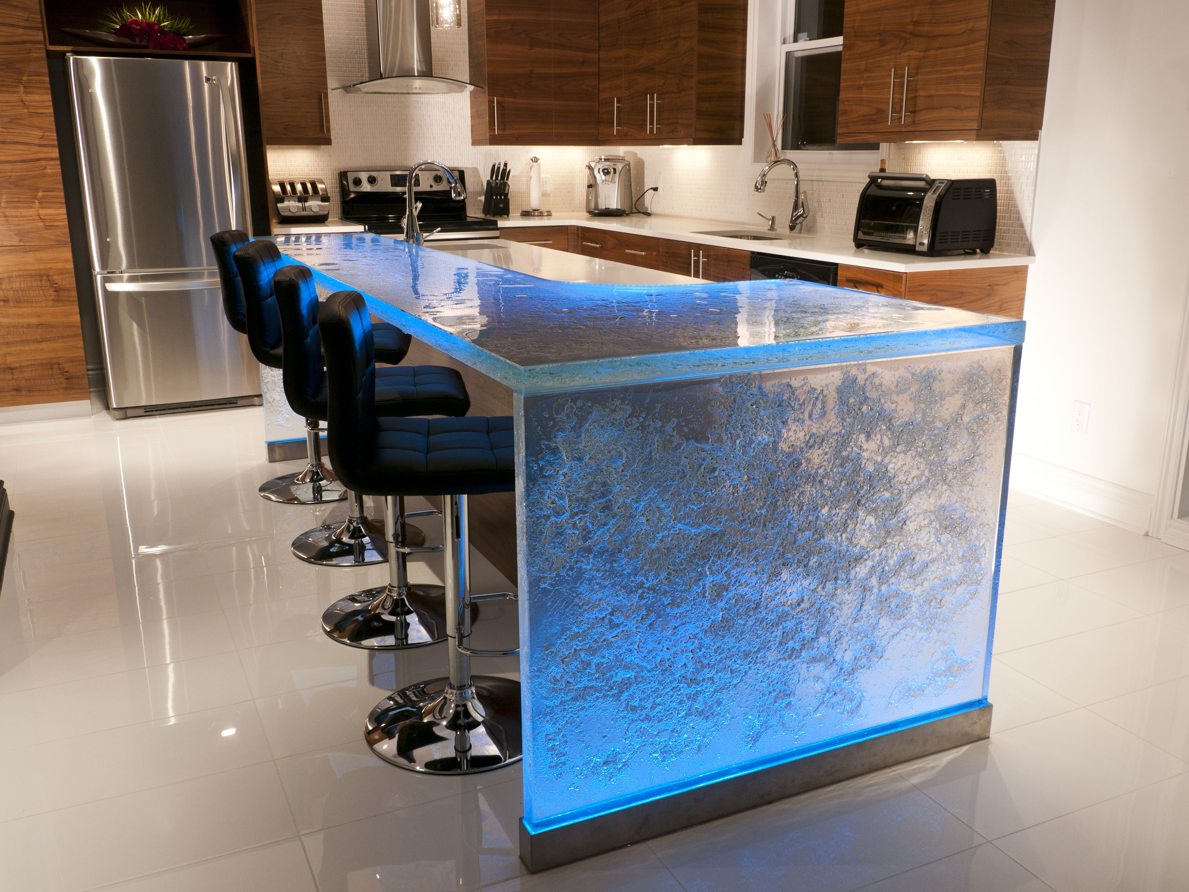 Beautifully textured raised bar with waterfall leg and LED lights ...